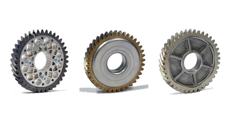 Leichtbauzahnräder in Mehrkomponentenbauweise mit Zahnkränzen aus 18CrNiMo7-6 und verschiedenen Radkörpervarianten; links: blechpaketierter Zahnradkörper (thermisch gefügt); mitte: tiefgezogener Zahnradkörper (thermisch gefügt); rechts: umformgefügter Zahnradkörper - Quelle: FOSTA e.V.